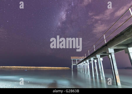 Milky way setting by a bridge in Penang - Stock Photo