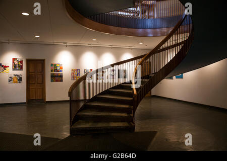 Circular staircase leads to the grand dining room in the Dining Hall building at  Groton School. Student art work - Stock Photo