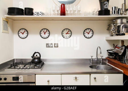 Foley House, Maddox Street. Small modern kitchen with stainless steel countertops and appliances. Contemporary kitchen - Stock Photo