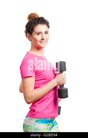 Sporty woman exercising with two black dumbbells  as sport and fitness concept isolated on white - Stock Photo