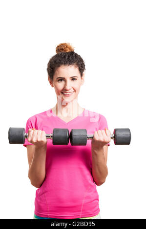 Active young woman working out with two dumbbells as fitness gym concept on white background - Stock Photo