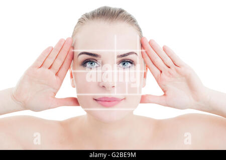 Portrait of woman with perfect skin divided by beauty marks as plastic surgery concept on white studio background - Stock Photo