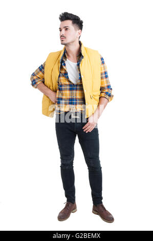 Fashion portrait of young man in trendy casual clothes posing on white studio background - Stock Photo