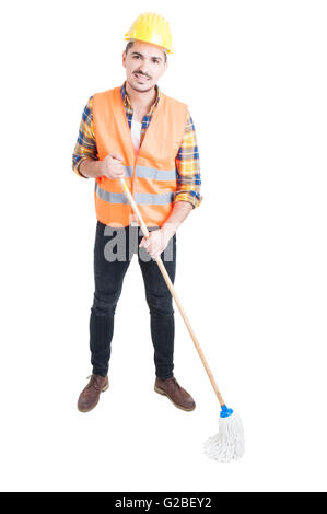 Young constructor with mop being ready to clean the floor in workwear and helmet isolated on white background - Stock Photo