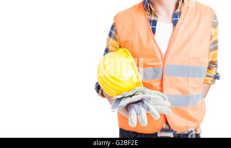 Closeup engineer holding helmet and wearing vest and gloves for safe constructions isolated on white background - Stock Photo