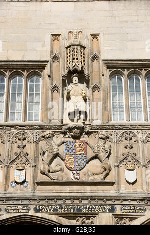 The ornate carvings on the entrance to Trinity College Cambridge UK - Stock Photo