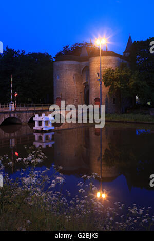 The Gate of Ghent - Gentpoort (1400) and Water tower (1925) in Bruges, Belgium - Stock Photo
