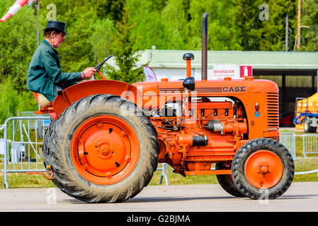 Emmaboda, Sweden - May 14, 2016: Forest and tractor (Skog och traktor) fair. Vintage classic tractors on parade. - Stock Photo