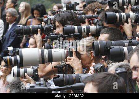 Photographers crammed into a pen at a Burberry fashion show during London Fashion Week. - Stock Photo