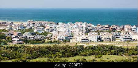 View of ticky tacky, oversized houses in over built beach town of Buxton on Hatteras Island, Outer Banks, North - Stock Photo