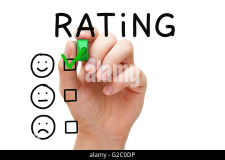 Hand putting check mark with green marker on excellent rating. Customer satisfaction concept. - Stock Photo