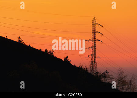 transmission tower at the sunset - Stock Photo