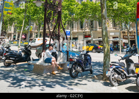 Spain Catalonia Barcelona Eixample Passeig de Gracia ornate Gaudi style combined bench seat & street standard light - Stock Photo