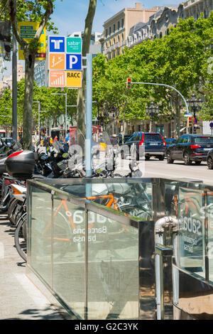 Spain Catalonia Barcelona Eixample Passeig de Gracia Metro subway underground station entrance motor bike cycle - Stock Photo