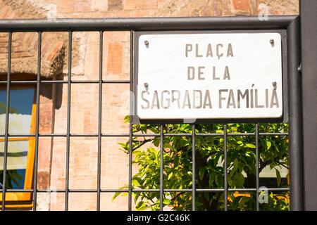 Spain Catalonia Barcelona Eixample road sign Placa de la Sagrada Familia - Stock Photo