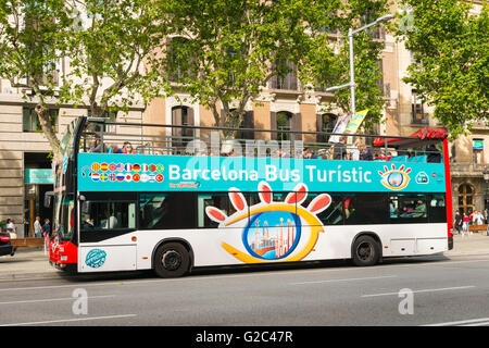 Spain Catalonia Eixample Passeig de Gracia Barcelona Bus Turistic tourist double decker open top - Stock Photo
