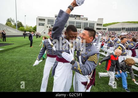 Tears stream down the face of West Point Cadet Alix Idrache as he is embraced by his friends during the 2016 commencement - Stock Photo