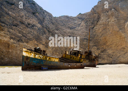 Old rusty boat at the white sands of Navagio Shipwreck  beach on Zakynthos. Greece - Stock Photo