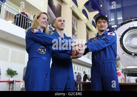 International Space Station Expedition 48 prime crew pose for photos at the Gagarin Cosmonaut Training Center May - Stock Photo