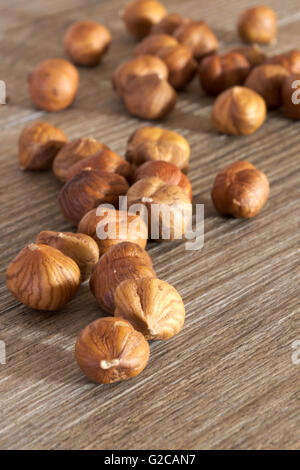 Hazelnuts on a wooden rustic table. - Stock Photo