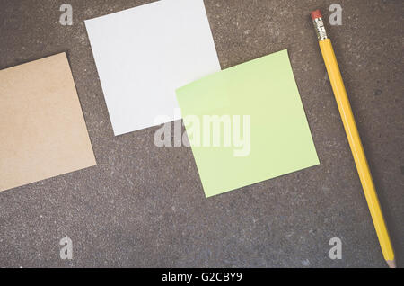 Blank Memos On A Rough Stone Surface Stock Photo, Royalty Free