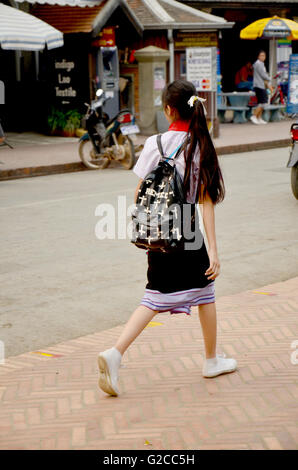 Children girl Laotian people walking on street go home after finish class from school on April 8 , 2016 in Luang - Stock Photo