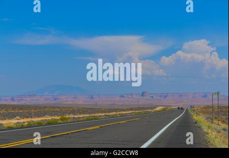 a long straight highway running through the desert in Utah - Stock Photo