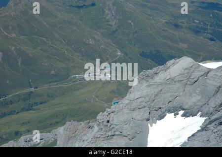 View from Jungfraujoch pass towards Kleine Scheidegg in Alps in Switzerland - Stock Photo