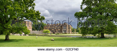 Stormy rain clouds behind Broughton castle in springtime. Near Banbury, Oxfordshire, England. Panoramic - Stock Photo