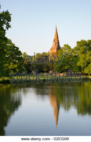St Mary the Virgin church in the grounds of Broughton castle in the evening summer sunlight. Near Banbury, Oxfordshire, - Stock Photo