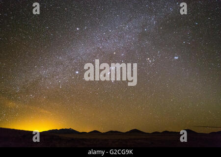 The Milky Way Galaxy shining over open land north of Flagstaff. Coconino National Forest, Arizona - Stock Photo