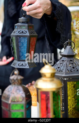 Emarati Arab woman holding dates plate and Ramadan Lamp, Dubai, United Arab Emirates. - Stock Photo