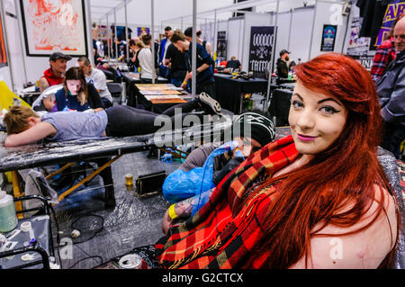 BELFAST, NORTHERN IRELAND. 28 MAY 2016 - 6th Northern Ireland Tattoo Conference. Many customers have tattoos all - Stock Photo