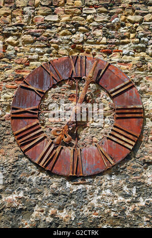 Old rusty clock on the wall beside Zagreb Cathedral in Zagreb, Croatia - Stock Photo