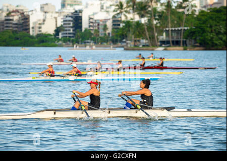 RIO DE JANEIRO - APRIL 2, 2016: Teams of rowers compete in a race on Lagoa Rodrigo de Freitas, an Olympics venue. - Stock Photo