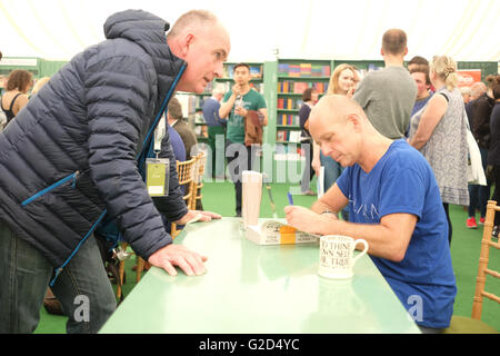 Hay Festival - Saturday 28th May 2016 - Steve Hilton signs a copy of his book More Human in the festival bookshop. - Stock Photo
