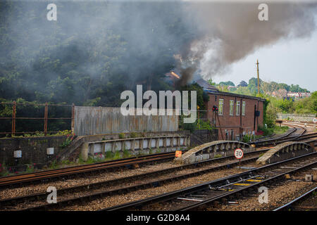 Salisbury, UK. 28th May, 2016. The fire alongside the tracks at Salisbury Station which delayed  the Flying Scotsmans - Stock Photo