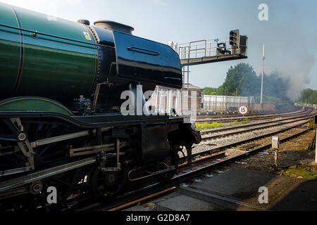 Salisbury, UK. 28th May, 2016. The Flying Scotsman Delayed by a trackside fire as she was about to leave Salisbury - Stock Photo