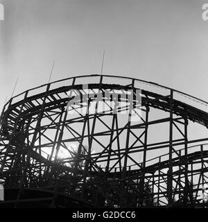Silhouetted Wooden Roller Coaster - Stock Photo