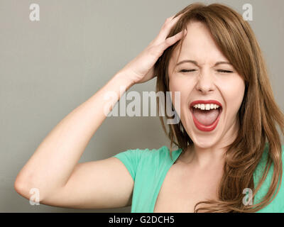 Portrait of a Frustrated Angry Woman Screaming in a Temper or Tantrum - Stock Photo