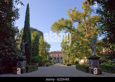 Giardino Corsini al Prato, Florence, Italy: view of the palace down the main path: trees and statuary in the garden - Stock Photo