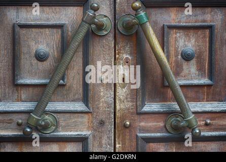 Fragment of old door with lock and door handles Stock Photo ...