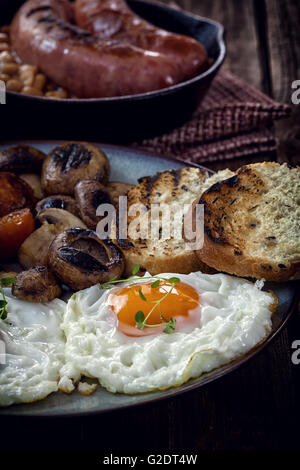 English breakfast with eggs, tomatoes, mushrooms, bacon, beans - Stock Photo