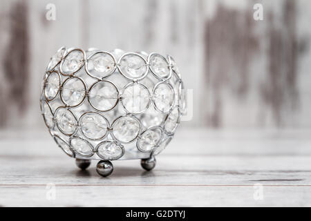 Candle holder with crystals on white wooden background - Stock Photo