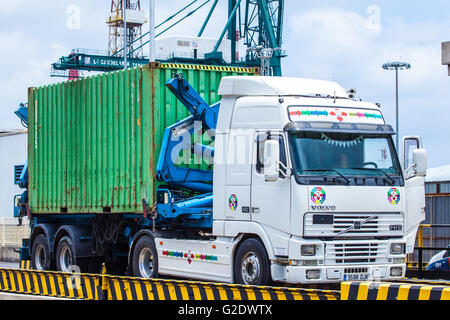 truck with container parked in a dock - Stock Photo