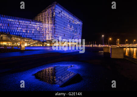 Illuminated Harpa, concert hall and conference center, at night, Reykjavik, Iceland - Stock Photo