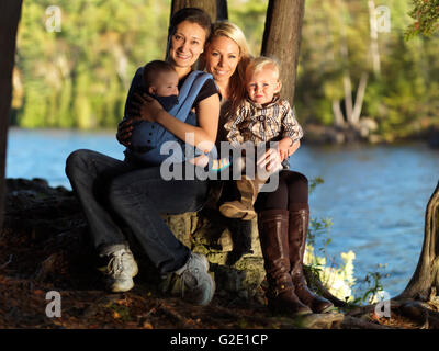 Two young mothers with their kids enjoying their time in the nature, Rockwood, Ontario Province, Canada - Stock Photo