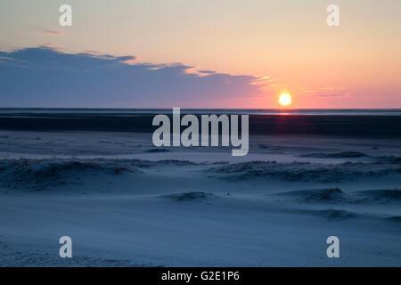 Sunset over the sand dunes on the Nordstrand beach, Lower Saxon Wadden Sea National Park, Borkum, East Frisian Islands - Stock Photo