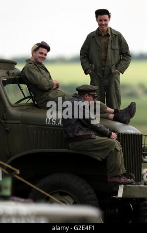 Re-enactors watch the action during the American air show at the Imperial war Museum Duxford in Cambridgeshire. - Stock Photo