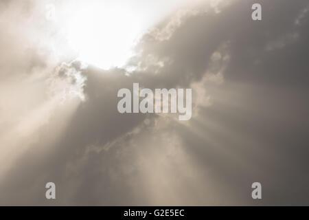 Cloud burst during sun rise - Stock Photo